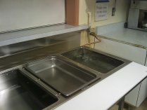 The stainless steel steam table, installed