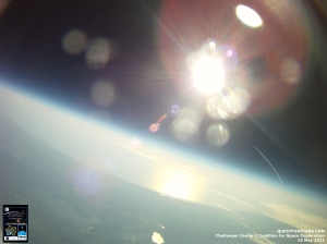 As the Space Shuttle Endeavour embarked on its last mission, two photos captured the first few moments of the launch: one from a helium-filled weather balloon, and another from an airline passenger's iPhone.