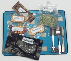 Bags of International Space Station food and utensils on a tray | Astronaut Chow: Space Food over the Years